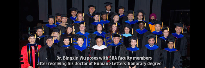 Dr. Bingxin Wu poses with SBA faculty members after receiving his Doctor of Humane Letters honorary degree.